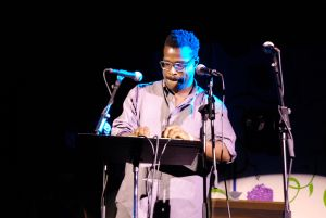 Tunde Adebimpe performing.